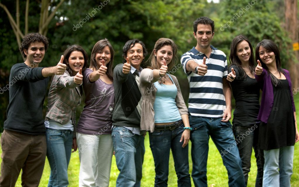 Large group of friends with thumbs up smiling outdoors — Stock Photo #7740544