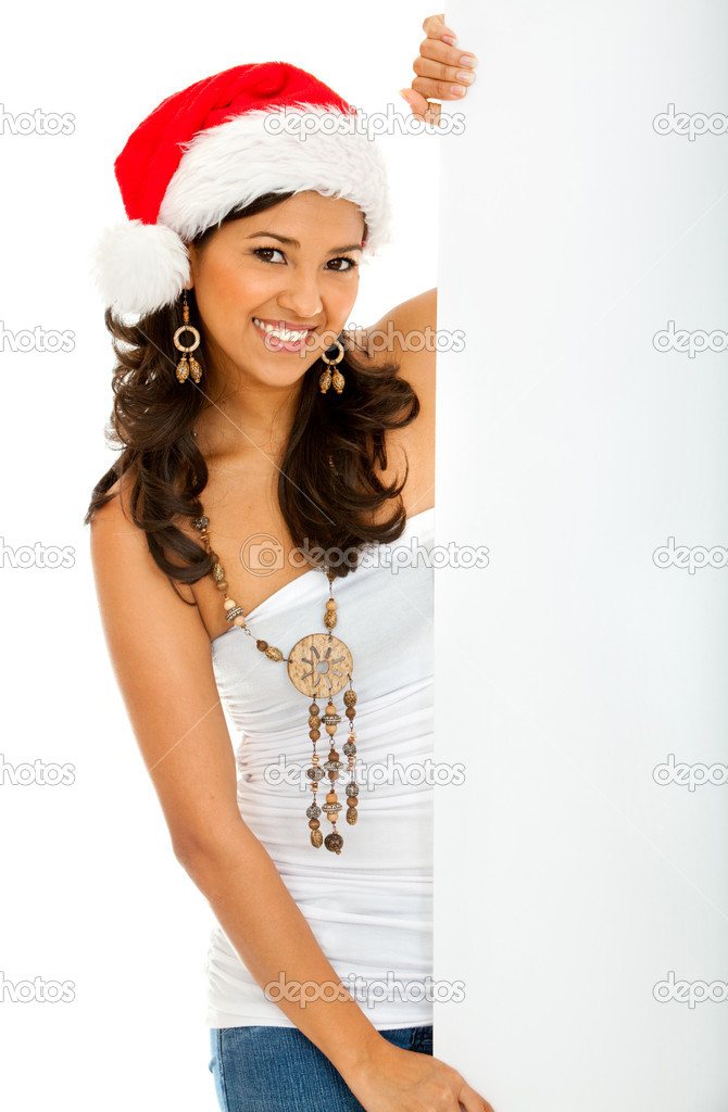 Christmas woman holding an ad isolated on white  Stock Photo #7740762