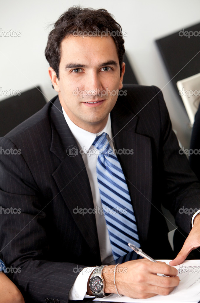 Handsome young business man at the office — Stock Photo #7741812