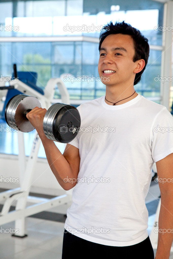 Man lifting free weights at the gym — Stock Photo #7742004
