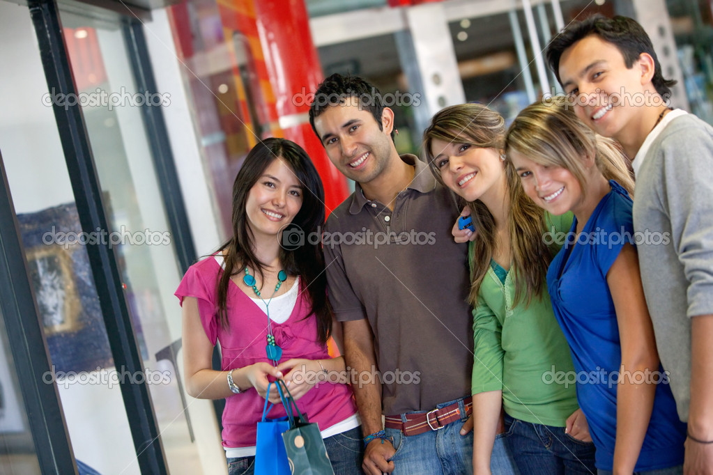 Group of friends shopping in a mall with some bags  Stock Photo #7744763