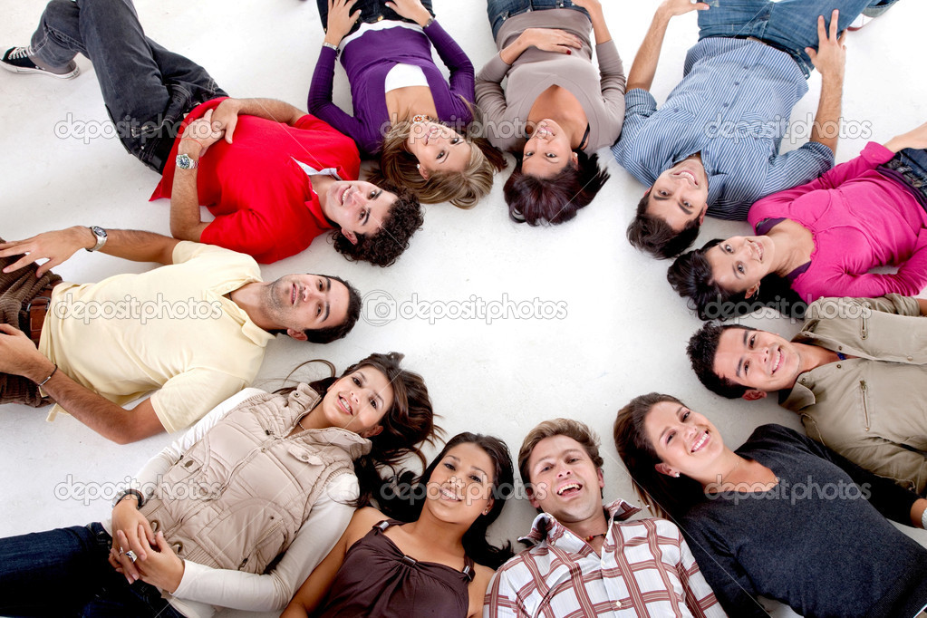 Large group of with their heads together on the floor — Stock Photo #7745908