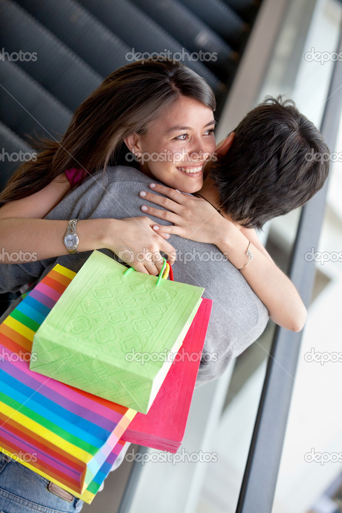Loving couple hugging at a shopping center  Stock Photo #7746634