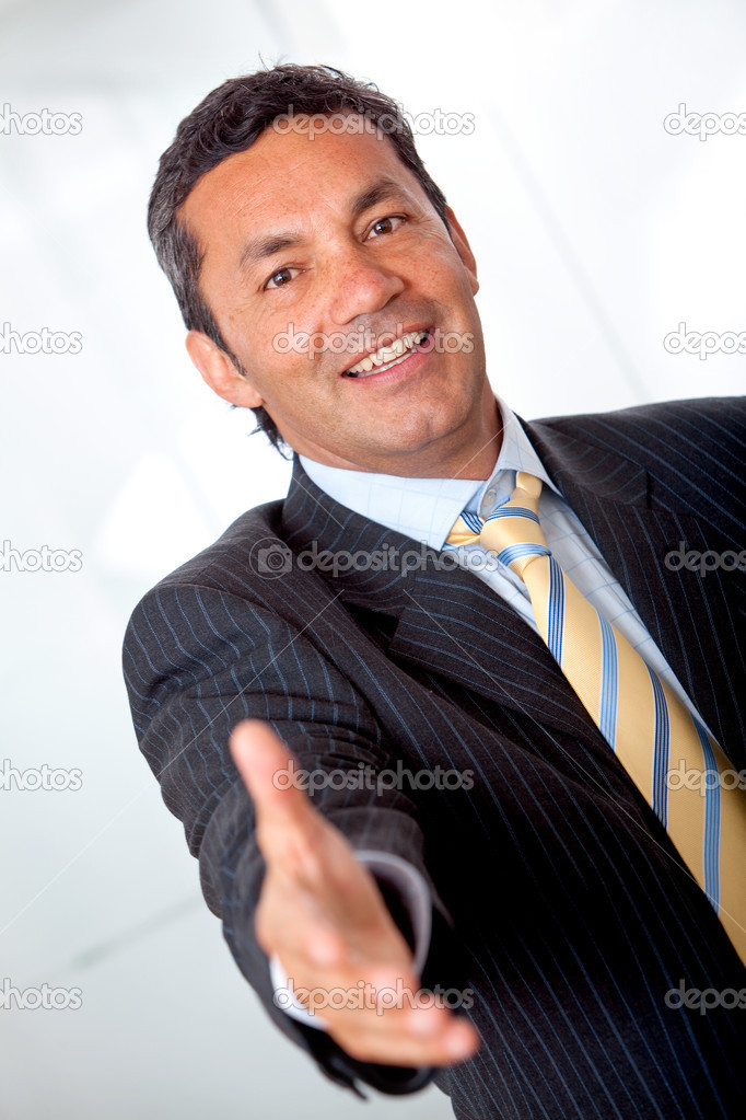 Business man extending his arm to handshake -isolated on white — Stock Photo #7747392