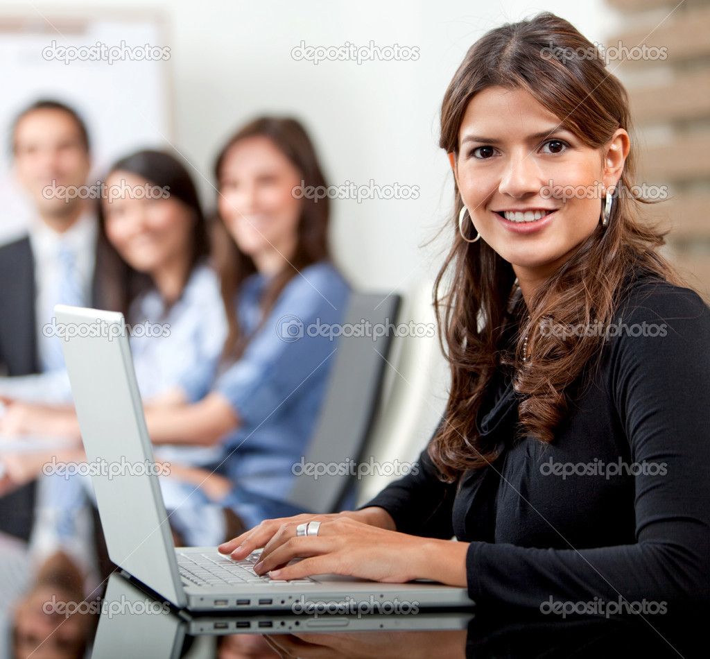 Group of business in an office - businesswoman on a laptop — Foto Stock #7748367