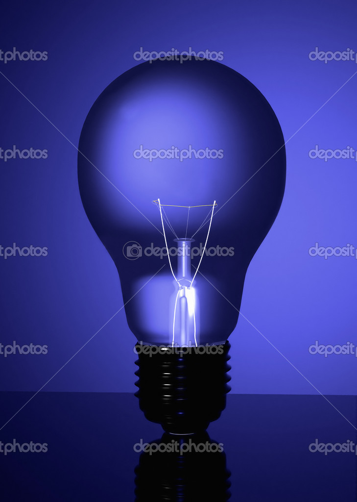 Blue lightbulb in blue colours made in 3d — Stock Photo #7749232