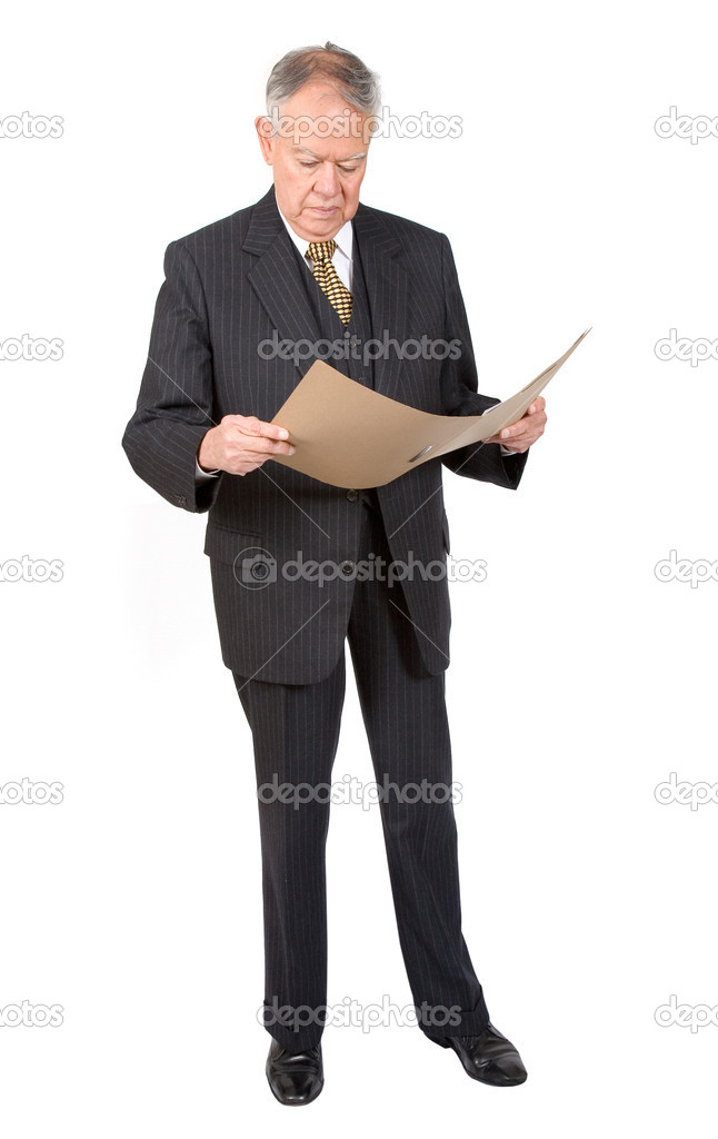 Business man reading a report over white — Stock Photo #7749357