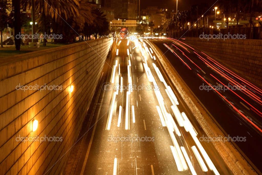 Moving traffic at night with moving lights — Stock Photo #7749514