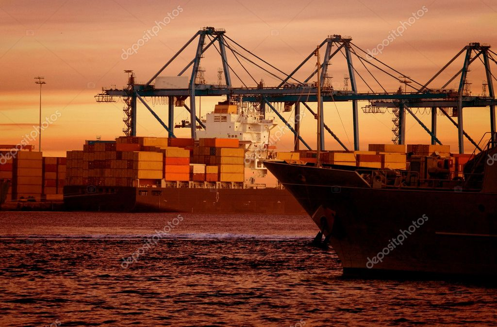 Cargo boat by the beach at sunset time in beautiful colours — Stock Photo #7749522