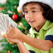 Christmas boy with money — ストック写真