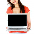 Casual girl displaying laptop — Foto Stock #7750239