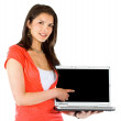 Casual girl displaying laptop — Stock Photo