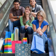 Shopping on escalators - Stock Photo