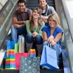 Shopping on escalators — Stock Photo