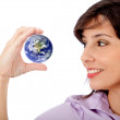Foto Stock: Business woman holding earth
