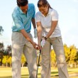 Learning golf - Stock Photo