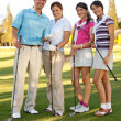 Stock Photo: Group of golf players