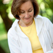 Woman reading outdoors — Stock Photo #7750779
