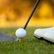 Stock Photo: Golf player hitting ball