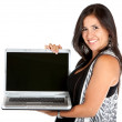 Woman holding a computer - Stock Photo