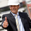 Engineer with thumb up - Stock Photo