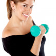 Woman liftying a free weight — Stock Photo #7750917