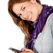 Happy woman texting on her phone — Stockfoto