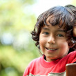 Little boy smiling outdoors — Stock Photo #7750942