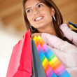 Beautiful shopping woman smiling — Stock Photo #7751045