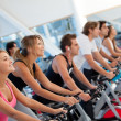 Gym on spinning machines - Stock Photo