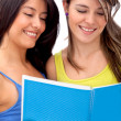 Women reading from a notebook — Stock Photo #7751144