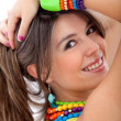 Girl with colorful jewelry - Stock Photo