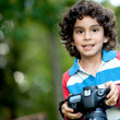 Beautiful boy with a camera — Stock Photo #7751303