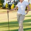 Woman playing golf — Stock Photo