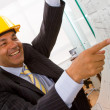 Male architect pointing at blueprints — Stock Photo #7751540