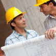 Architects at construction site — Stock Photo #7751863