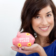 Woman with a piggybank — Stock Photo #7751890
