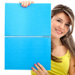 Girl holding a notebook — Stock Photo