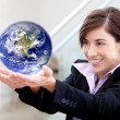 Business woman holding earth — Stok fotoğraf