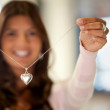 Cheerful woman with silver necklace — Stock Photo