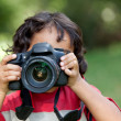 Stock Photo: Little boy with camera
