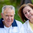 Retired couple at the park — Stock Photo