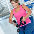 Woman at the gym exercising — Stock Photo #7752143