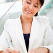 Business woman signing a contract — Stock Photo #7752185