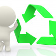 3D man with hand on recycling sign - Stock Photo
