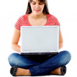 Girl sitting with a laptop — Stock Photo