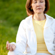 Stock Photo: Retired woman practicing yoga