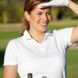 Female golf player — Stockfoto