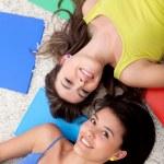 Female students lying on the floor — Stock Photo