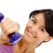 Womlifting free weights — Stock Photo #7752300